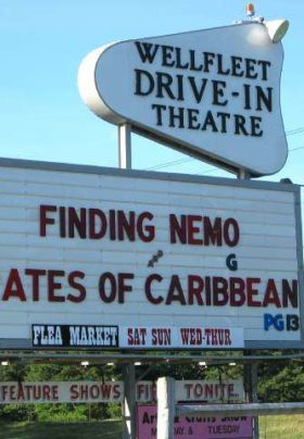 Wellfleet Drive-In Theatere sign that reads: Finding Nemo, G and Pirates of the Caribbean, PG13