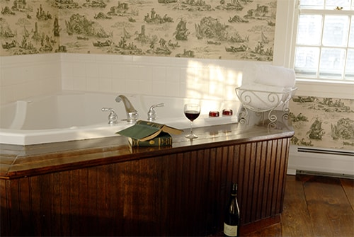 Eliza Jane Suite bathroom showing double whirlpool Jacuzzi tub and red wine