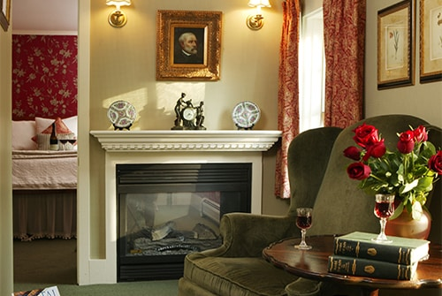 Eliza Jane Suite living room showing red roses and two reading chairs