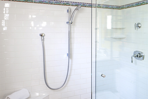 Garden Room guest bath shower with white tile and glass doors