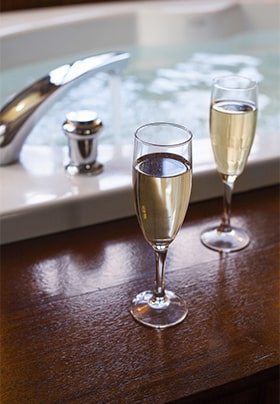 Champagne near soaking tub