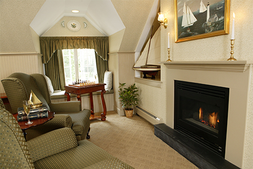 Lydia Harding suite with window, upholstered wing chairs and fireplace