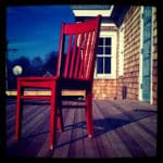 Red wooden chair on the deck
