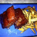 Blue plate of BBQ ribs and homemade French fries